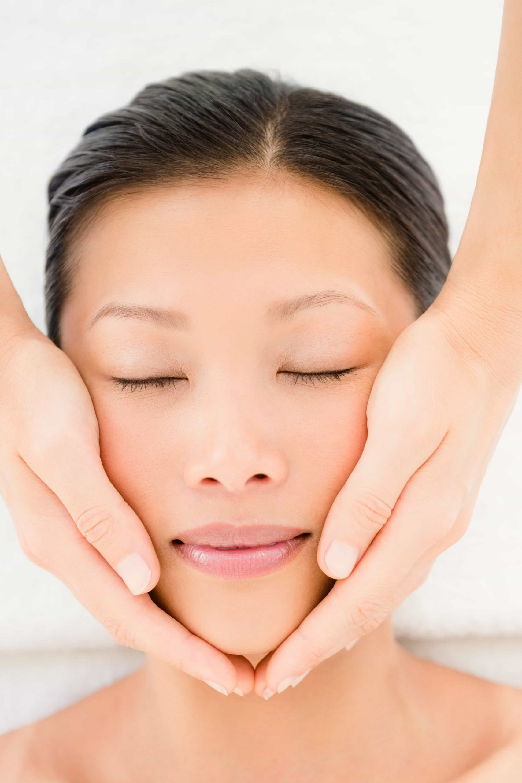 picture of hands around face relaxing